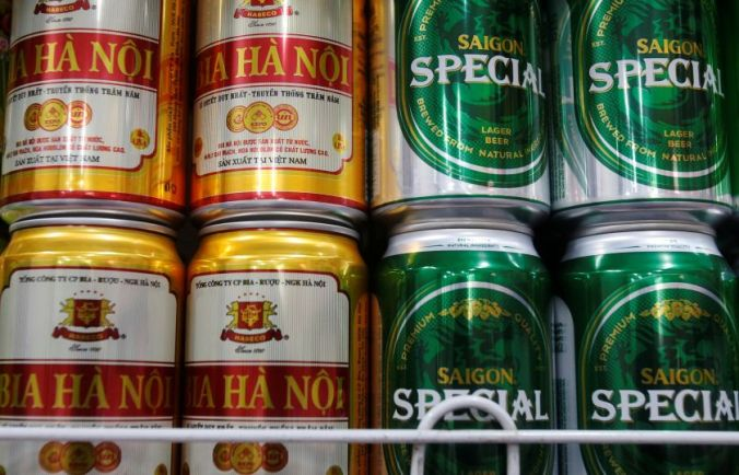 Cans of Hanoi Beer and Saigon Beer are seen displayed for sale at a mini-mart in Hanoi